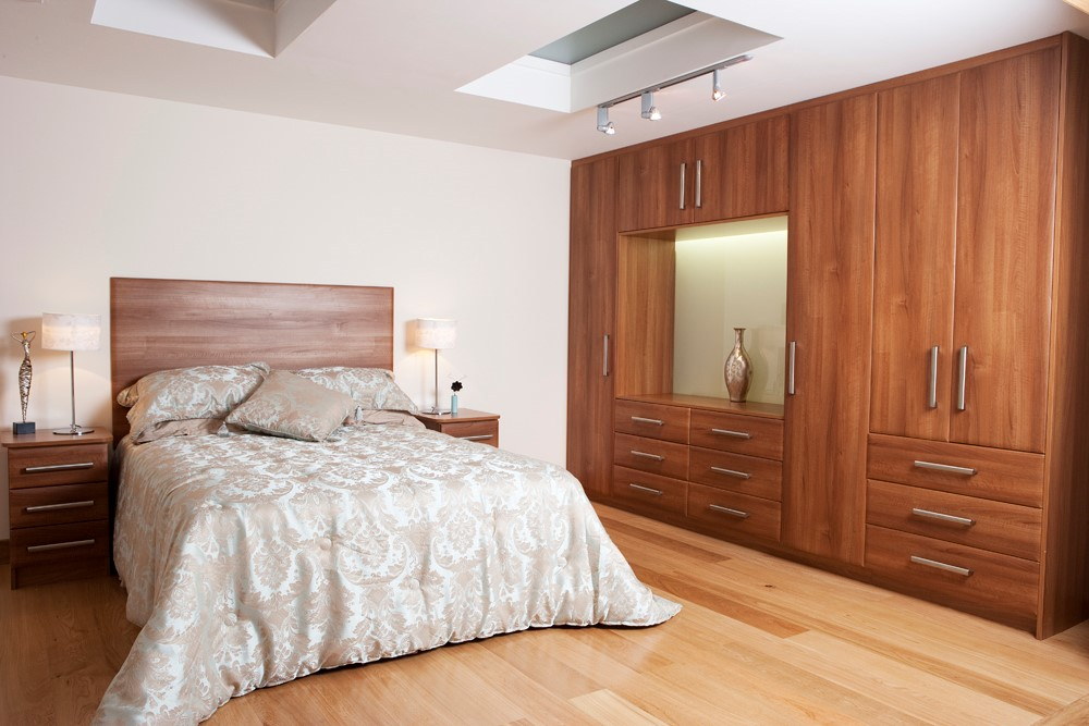 Light walnut vinyl wrap wardrobes with pillar handles.