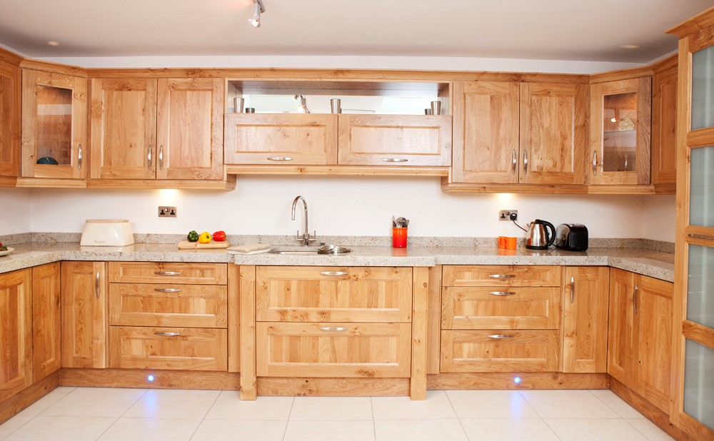 White Oak Stepped shaker with 60mm Ivory fantasy granite counter top. Handles: Zurich stainless steel 160mm centres.