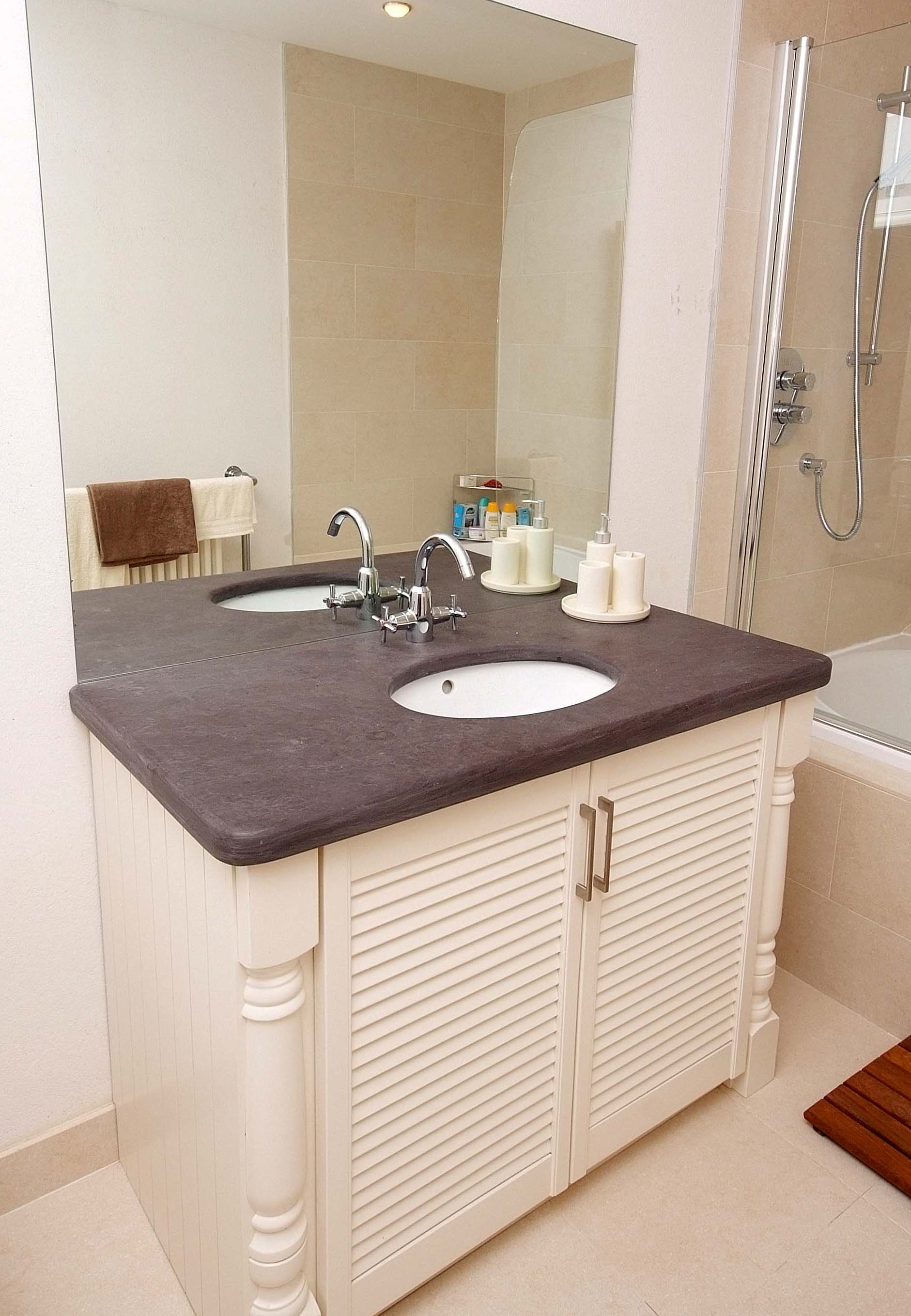 Solid Ash painted vanity unit with 40mm Valentia slate counter top.